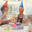 Stock Video: Elderly friends celebrating a birthday