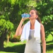 Stock Video: Womdrinking water after sports