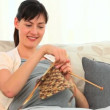 Future mother knitting - Stockfoto