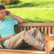 Handsome man using his phone outdooors — Stock Video