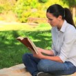 Attractive woman reading outdoors — Stock Video