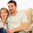 Stock Video: Casual young couple looking at tv