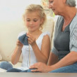 Royalty-Free Stock Vector: Gril learning to knit with her grand mother
