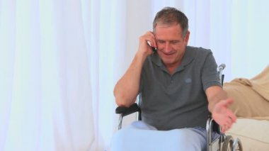 A male in a wheelchair having a phone call — Stock Video
