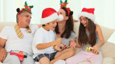 Family during Christmas with crackers — Stock Video