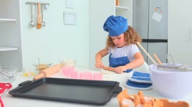 Adorable little girl baking — Stockvideo