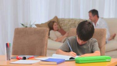 Adorable boy doing his homeworks — Stock Video