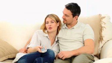 Pretty couple watching tv — Stock Video