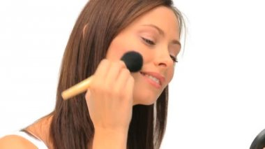 Wonderful brunette putting on make-up — Stock Video #15545355