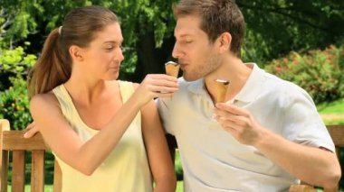 Couple eating ice creams — Stock Video