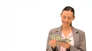 Joyful businesswoman counting her money against a white background — Stock Video