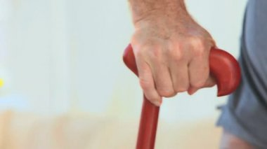 A man holding a walking stick — Stock Video