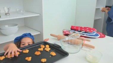 A little girl stealing cookies — Stock Video