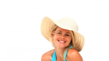 Happy blond woman in swimsuit with an hat — Stock Video