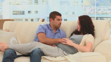 Relaxed couple on the sofa having a good time at home — Stock Video
