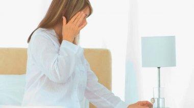 An elderly woman having an headache — Stock Video