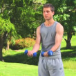 Stock Video: Dynamic mwith dumbbells