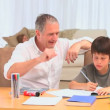 Stock Video: Little dark-haired boy doing homeworks
