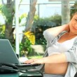 Tired pregnant woman working - Stock Photo