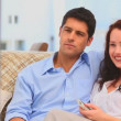 Stock Video: Couple laughting in front of tv