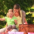Mother with her daughter eating watermelon  — Vídeo de stock
