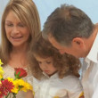 Royalty-Free Stock Векторное изображение: Family creating a bunch of flowers