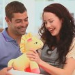 Man offering  a cuddly toy to his wife — Stock Video