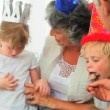 Stock Video: Lovely family eating a birthday cake