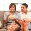 Stock Video: Couple watching tv with popcorn