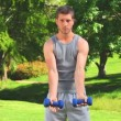 Stock Video: Athletic mdoing exercises outdoors