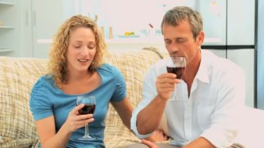 Lovely couple enjoying a red wine — Stock Video