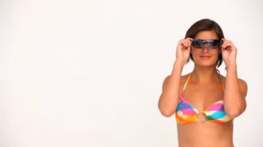 Wonderful brunette in swimsuit with sunglasses — Stock Video