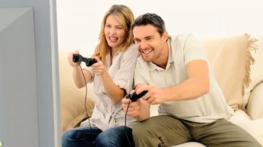 Young couple playing a video game — Stock Video