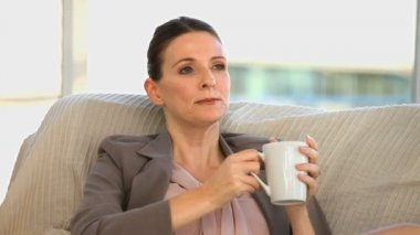 Brunette middle aged lady drinking a cup of coffee — Stock Video