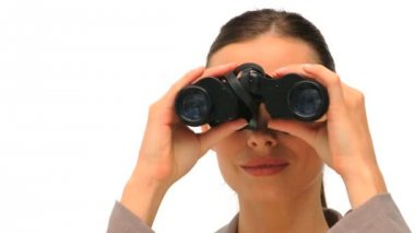 Lovely woman looking through binoculars — Stock Video