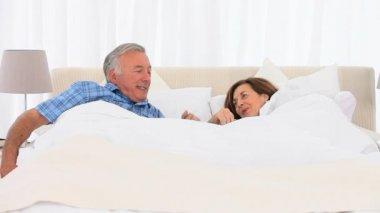 Mature couple waking up — Stock Video