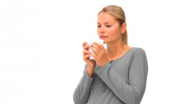 Casual woman drinking a cup of coffee — Stock Video