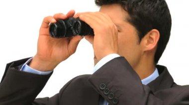 Businessman looking through binoculars — Stock Video