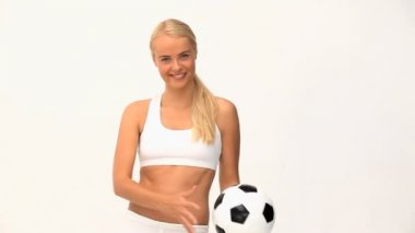 Blond woman playing with a ball — Video Stock