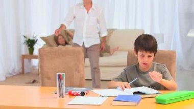 Adorable little boy doing his homeworks — Stock Video