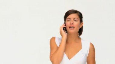 An attractive brunette beauty having a phone call — Stock Video