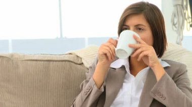 Brunette drinking a cup of tea — Stock Video