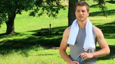 Handsome man after exercise — Stock Video