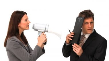 Businesswoman giving orders through a megaphone — Stock Video