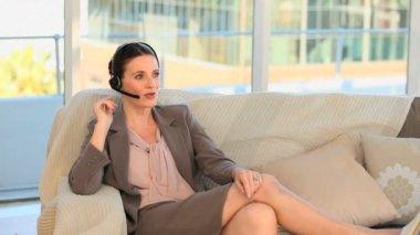 Brunette speaking over the headset — Stock Video
