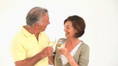 Mature couple drinking white wine — Stock Video
