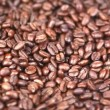 Coffee beans turning - 图库照片