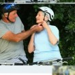 Stock Video: Montage of mature couples relaxing and cycling