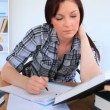 Attractive female student working - Stock Photo