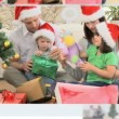 Stock Video: Montage of families celebrating Christmas Day together